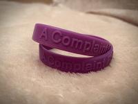 Отдается в дар Фиолетовый браслет «Мир без жалоб»