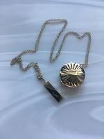 Отдается в дар Парфюм-украшение медальон