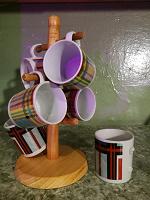 Отдается в дар Набор из пяти кофейных чашек на подставке.