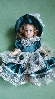 Отдается в дар куколка фарфоровая