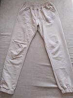 Отдается в дар Модные спортивные брюки 42 размер