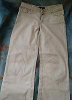 Отдается в дар джинсы белые 44р