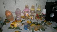 Отдается в дар бутылочки и молокоотсос