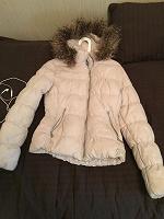 Отдается в дар теплая куртка 40-42 размер