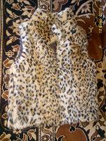 Отдается в дар Меховая жилетка на 104 размер.