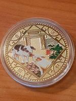 Отдается в дар Монетовидный жетонМонетой год свинки