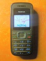 Отдается в дар телефон Nokia 1208